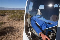 "A test flight dummy named ""Mannequin Skywalker"" sits in Blue Origin's crew capsule in West Texas after launching to the edge of space Dec. 12, 2017."