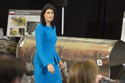 U.S. Ambassador to the U.N. Nikki Haley walks past recovered remains of an Iranian rocket during a press briefing at Joint Base Anacostia-Bolling on Dec. 14, 2017, in Washington.