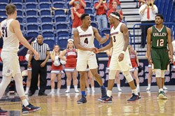 Duquesne players Rene Castro Caneddy, #4, and Tarin Smith, #3, share a moment as Duquesne University defeats Mississippi Valley State 73-49 Wednesday, Dec. 13, 2017, at the A.J. Palumbo Center in Uptown, Pittsburgh.