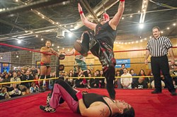 """The Enigma"" Lucio Deveer gets ready to slam Shane Starr as Jay Flash, back left, and Mike Malachi, back right, and referee Jimmy James look during the Keystone State Wrestling Alliance FanFest Dec. 2, 2017, at Spirit in Lawrenceville."