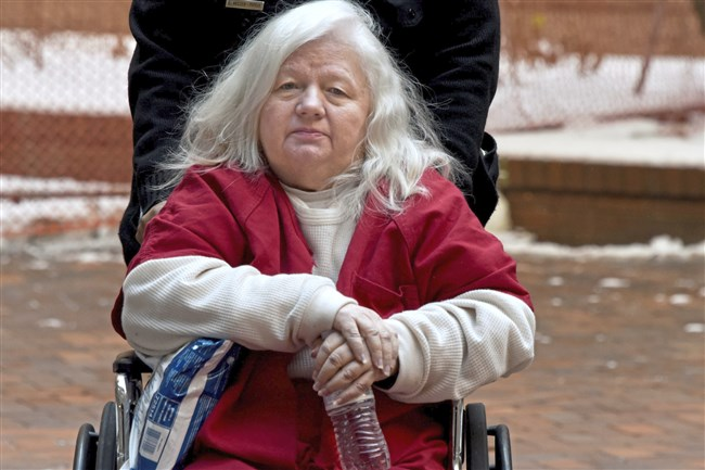 Martha Bell leaves the Allegheny County Courthouse Thursday after pleading guilty before Common Pleas Judge David Cashman on charges she swindled a man in his 80s out of $322,000.