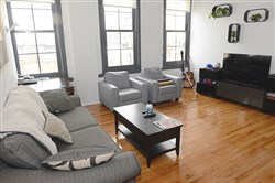 The living room of a one-bedroom apartment in the Brass Building  Lofts on Penn Avenue in the Strip District.