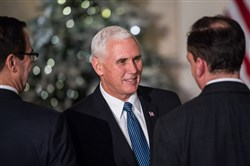 Vice President Mike Pence shake hands before President Donald Trump makes remarks on tax reform at the Grand Foyer of the White House on Wednesday. MUST CREDIT: Washington Post photo by Salwan Georges