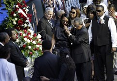 In this Aug. 4, 2010, file photo, Sherra Wright, the ex-wife of slain NBA basketball player Lorenzen Wright, grieves at the casket of Lorenzen Wright during a memorial service at the FedExForum in Memphis, Tenn.