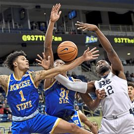 McNeese State's Kalob Ledoux and Stephen Ugochukwu go for a rebound against Pitt's Peace Ilegomah in the first half Saturday afternoon at Petersen Events Center.