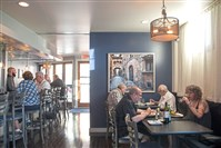 Customers enjoy drinks and food at 131 East restaurant in Carnegie.