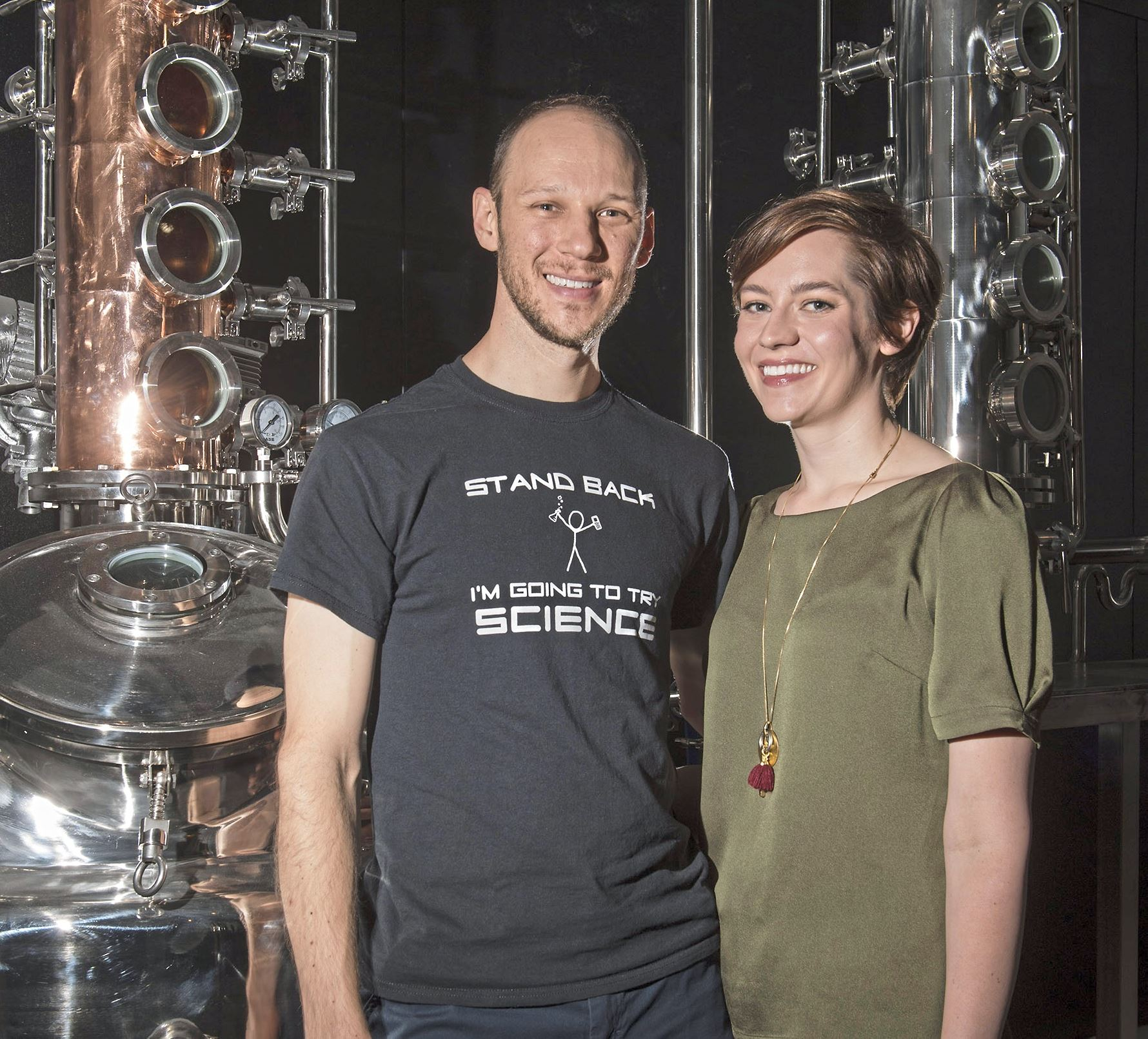20171012scCarnegie22-2 Owners Ryan and Sarah Kanto pose for a portrait with their still at Quantum Spirits distillery in Carnegie.