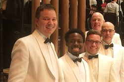 Josh Jones (second from left) and the percussion section of the Pittsburgh Symphony Orchestra.