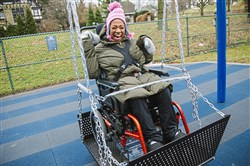 Jordan Comans, 17, of Friendship enjoys a newly installed wheelchair swing at Mellon Park's Dan Cohen Playground on Monday in Shadyside.
