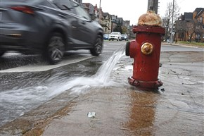 Water is released from a hydrant at the corner of Baum Boulevard and South Negley Avenue because of the water main break in this Dec. 18, 2017 file photo.