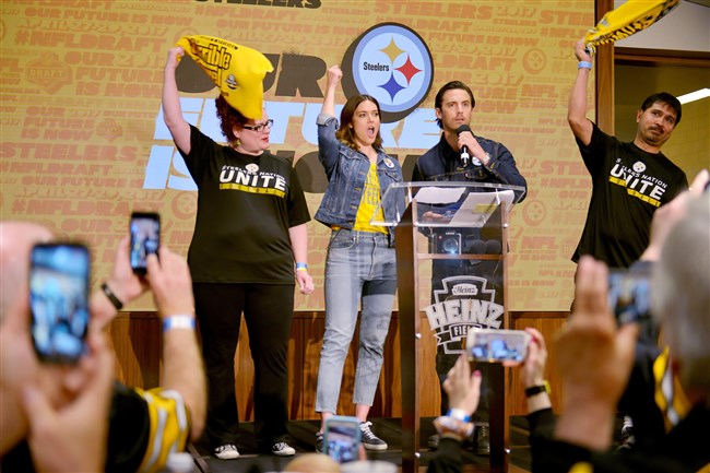 "While fans record the moment on their phones, Mandy Moore and Milo Ventimiglia, co-stars on the NBC show ""This is Us,"" announce the Steelers' fourth-round draft pick during the annual Steelers Fan Blitz at Heinz Field Saturday, April 29, 2017."