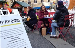 People converse over soup in Market Square.