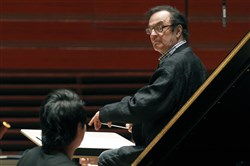 In this Oct. 19, 2011, file photo, world-renowned conductor Charles Dutoit, right, performs with the Philadelphia Orchestra during a rehearsal in Philadelphia.