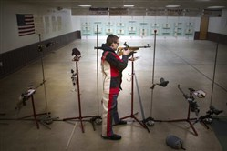 Deegan Ramsey holds his rifle after shooting practice at the Everett Sportsman's Club in Everett, Pa., on Dec. 12.