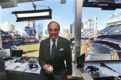 In this Sept. 29, 2016, file photo, Dick Enberg, the voice of the San Diego Padres, poses in his booth prior to the Padres' final home baseball game of the season in San Diego.