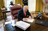 President Donald Trump signs a sweeping tax bill in the Oval Office of the White House, in Washington, on Dec. 22.