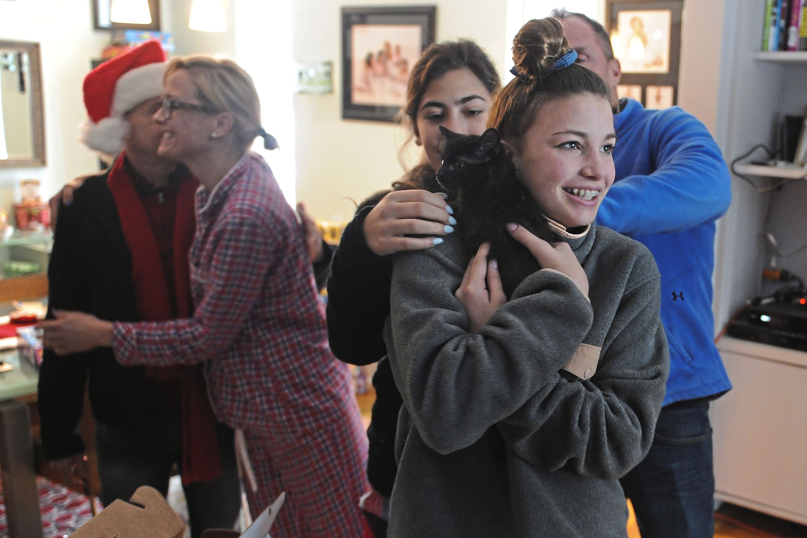 20171225ng-Kitten4 Piper Reck, 14, holds one of the two 9-week-old kittens at her home in Squirrel Hill.