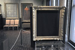 "In this March 11, 2010 photo, empty frames from which thieves took ""Storm on the Sea of Galilee,"" left rear, by Rembrandt and ""The Concert,"" right foreground, by Vermeer, remain on display at the Isabella Stewart Gardner Museum in Boston. Midnight Dec. 31, 2017, is the deadline to collect a doubled reward being offered for information leading to the recovery of 13 works worth an estimated $500 million."