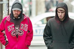 "Robert Pattinson, left, protects his brother, Ben Safdie, in ""Good Time."""