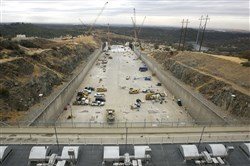 In this Oct. 19, 2017, file photo, crews work to repair the damaged main spillway of the Oroville Dam in Oroville, Calif.