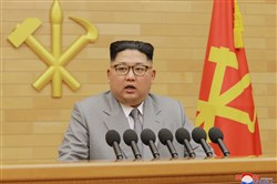 In this photo provided by the North Korean government, North Korean leader Kim Jong Un delivers his New Year's speech at an undisclosed place in North Korea on Jan. 1, 2018.