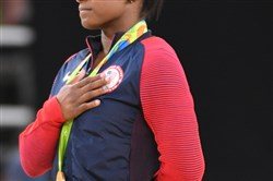 This file photo shows Simone Biles  after she earned the gold medal in the women's floor exercise — her favorite event — Aug 16, 2016 at the Rio Games.