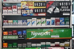 In this May 18, 2017, file photo, packs of cigarettes are offered for sale at a convenience store in Helena, Mont.