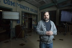 "This file photo shows Dan Harmon, the creator of NBC's ""Community,"" on set at Paramount Pictures in Los Angeles on Dec. 4, 2013."