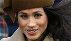 In this file photo dated Dec. 25, 2017, Meghan Markle, fiancee of Prince Harry, walks with members of the British Royal family for the traditional Christmas Day church service at St. Mary Magdalene Church in Sandringham, England.