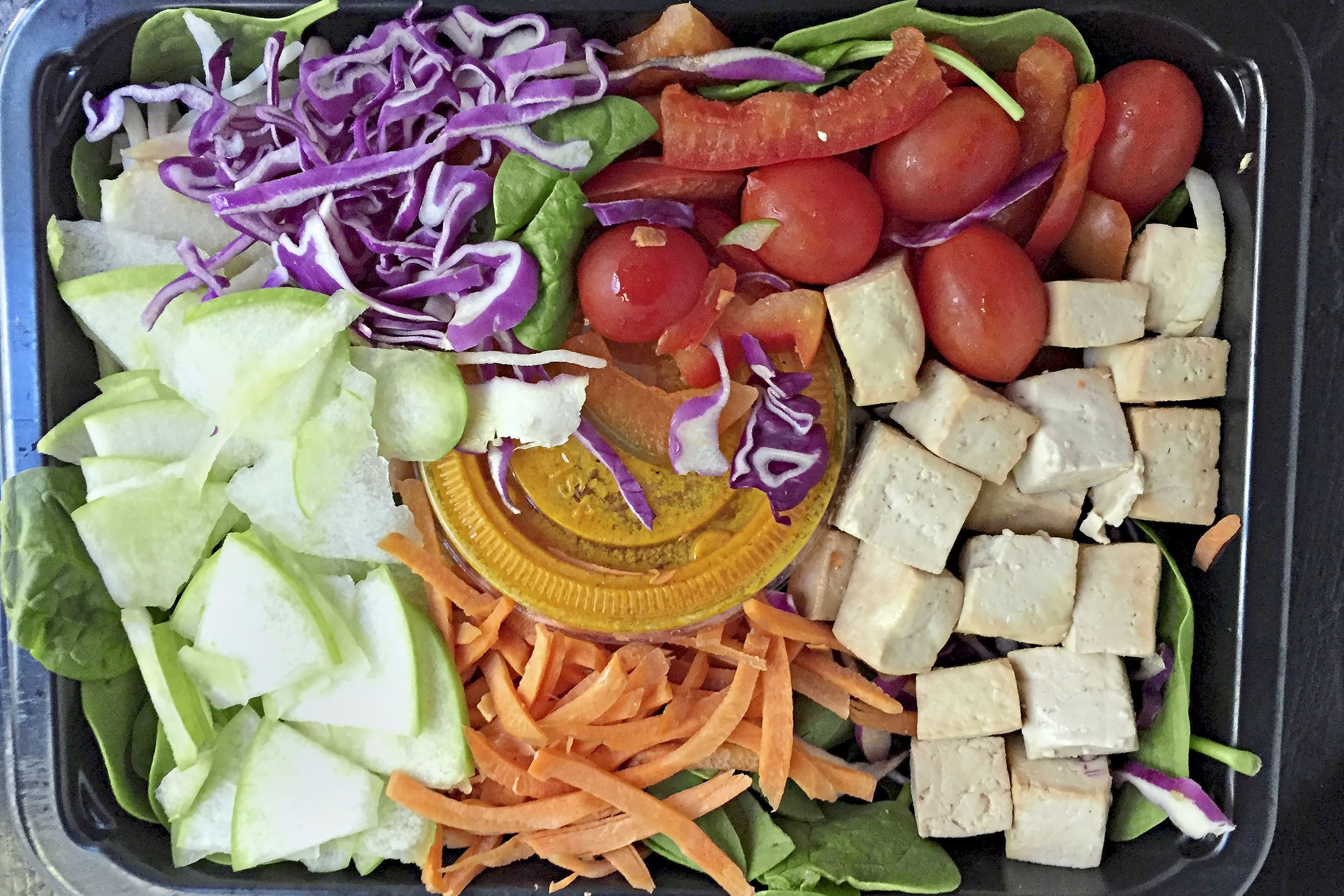 sprinly salad 2-2 Sprinly's weekly selections include cold dishes, such as this vegan Japanese Carrot Ginger Salad with tofu.