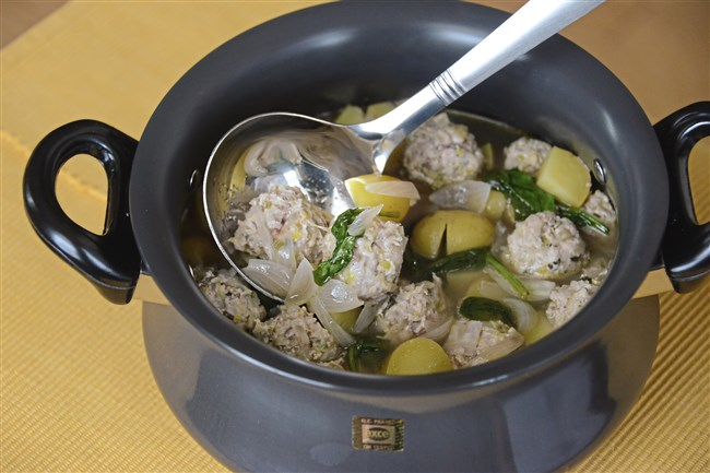 Chicken Meatballs in Lemon Broth.  Diced leeks and fennel are combined with ground chicken to make the meatballs, which are poached in a lemony broth in this soup.