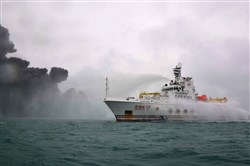 In a photo provided by the Transport Ministry of China on January 8, 2018, a Chinese firefighting vessel douses the burning Panamanian-flagged tanker, the Sanchi, which collided with the CF Crystal, a Hong Kong-registered bulk freighter, off the eastern coast of China on Jan. 6.