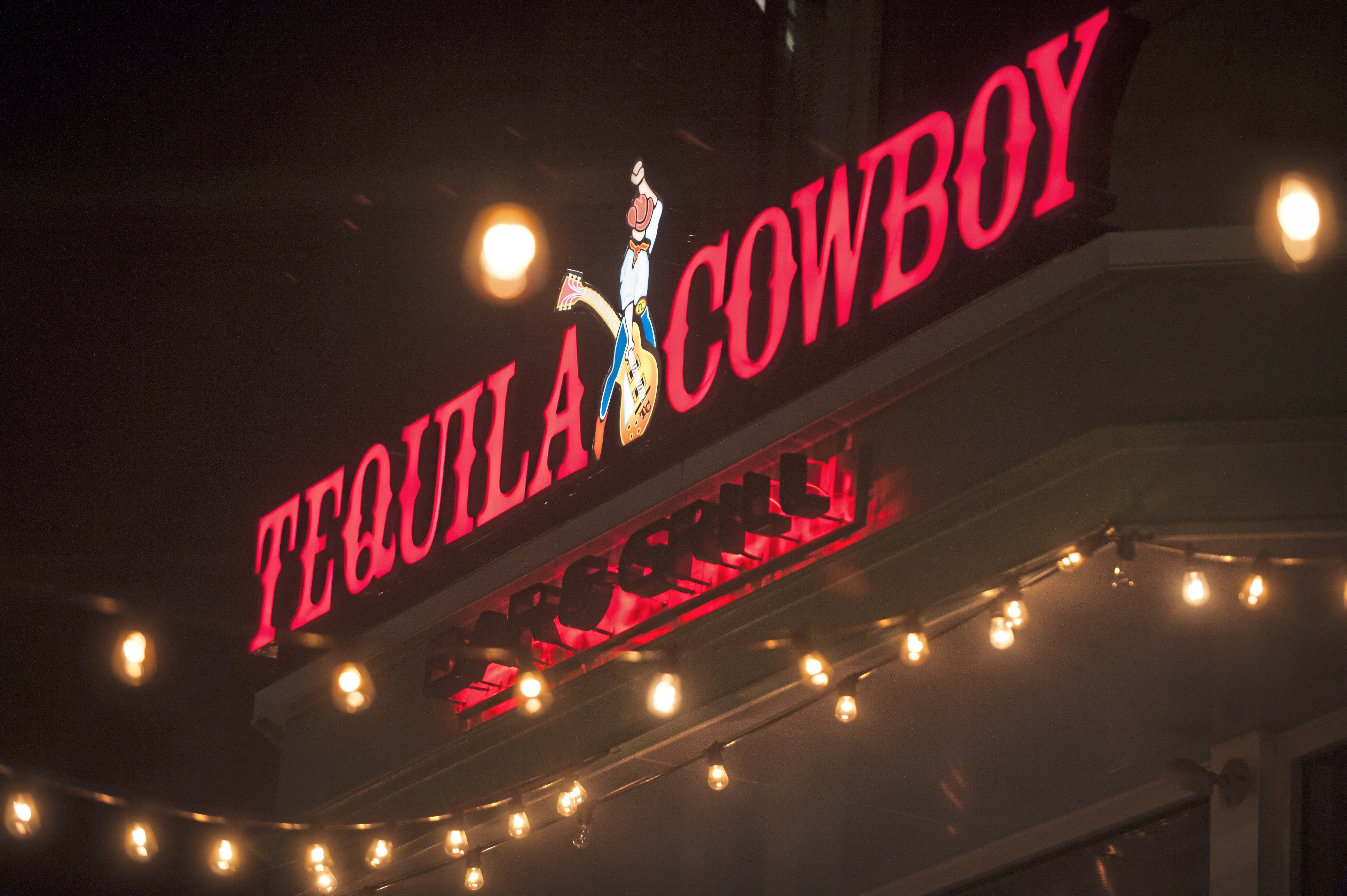 """20180107smsTequila02-1 Lights shine at the entryway for Tequila Cowboy on Sunday, Jan. 7, 2018 along the North Shore by Heinz Field. On New Years Eve, Steelers offensive coordinator Todd Haley injured his hip and was escorted out of the bar after his wife Christine Haley was in a """"minor scuffle"""" at the establishment. (Stephanie Strasburg/Post-Gazette)"""