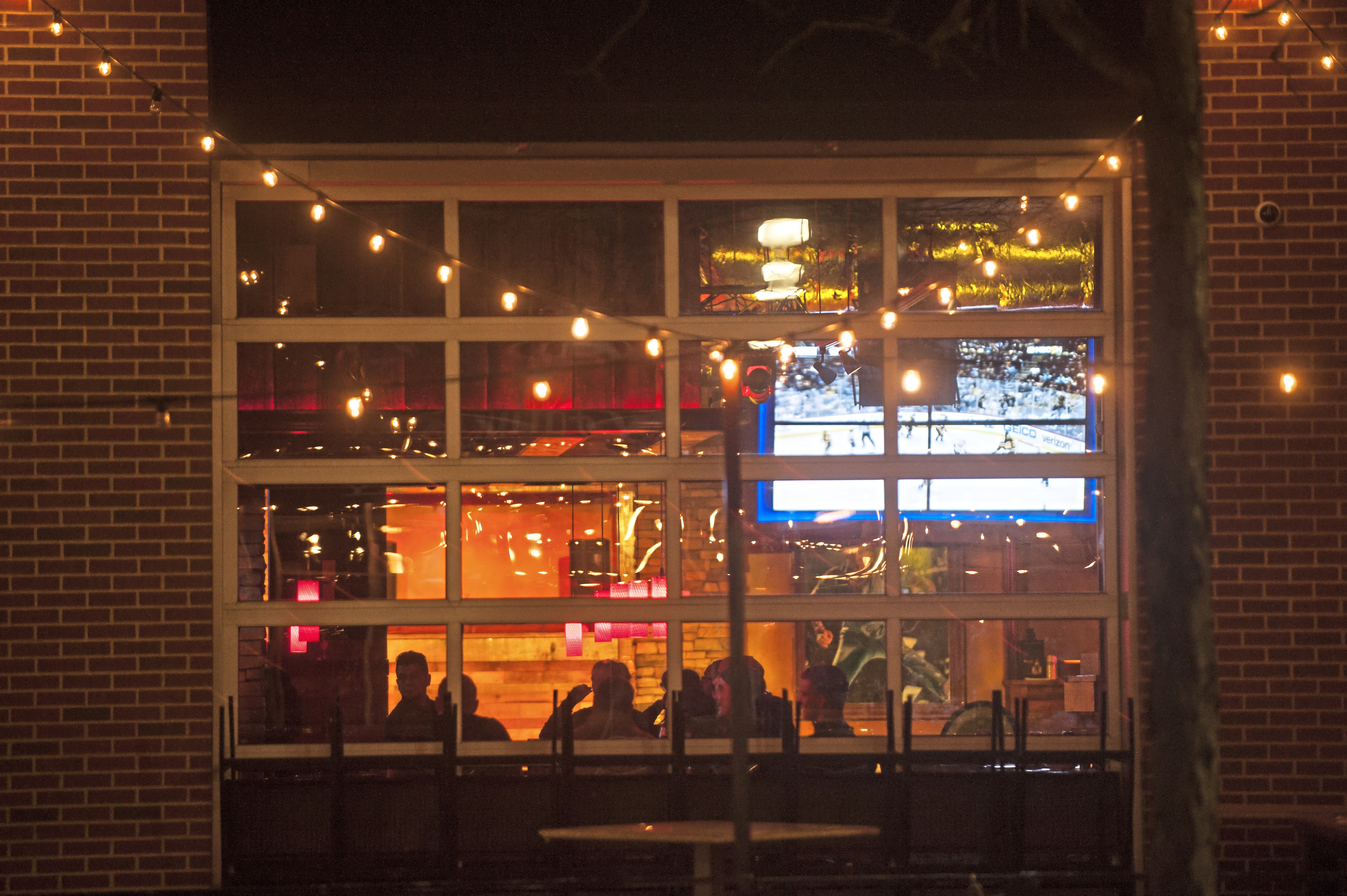"""20180107smsTequila04-3 Lights shine at the window of Tequila Cowboy on Sunday, Jan. 7, 2018 along the North Shore by Heinz Field. On New Years Eve, Steelers offensive coordinator Todd Haley injured his hip and was escorted out of the bar after his wife Christine Haley was in a """"minor scuffle"""" at the establishment."""