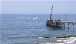 This May 16, 2015, file photo shows oil drillings offshore of a service pier in the Santa Barbara Channel off the coast of Southern California near Carpinteria.