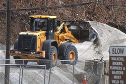 A front end loader is used to move salt near the Public Works 3rd Division Garage near Second Avenue on Friday.