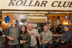 Ben Soltesz, left, and Stephanie Brea pose for a shot at the bar of South Side's Kollar Club, one of the Pittsburgh-area ethnic and social clubs they'll be visiting this year with their new Roaming Social Club.