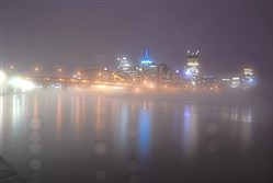A hazy fog is highlighted by the lights of the skyline over the Allegheny River, Friday January 12, 2018 in this view from the North Shore of Pittsburgh.