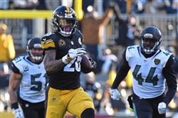 Steelers running back Le'Veon Bell picks up first down against the Jaguars in an AFC division round playoff game last month.