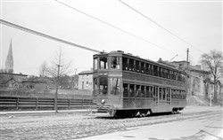 A double-decker street car rolling through Oakland in March 1917.