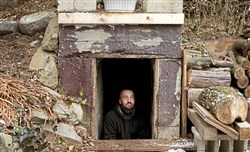Seth Brokenbek sits in the entrance of the 1960s-era Cuban Missile Crisis shelter that was built into the hillside next to his Murrysville home, which he purchased six years ago.