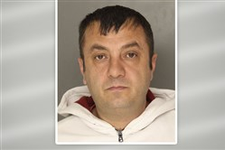Mahmut Yilmaz is accused of assaulting a woman inside Pizza Milano in Uptown.