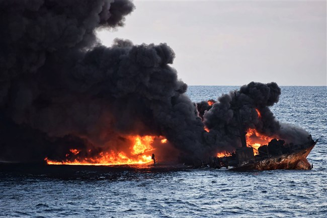 """This handout file picture from the Transport Ministry of China taken and released January 14, 2018, shows smoke and flames coming from the burning oil tanker """"Sanchi"""" at sea off the coast of eastern China."""