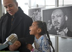 "Gabrielle Gressem, 6, celebrates with her father, John, after she'd read a portion of the Rev. Martin Luther King Jr.'s famous ""I Have a Dream"" speech at the Children's Museum of Pittsburgh in the North Side on Monday. ""He changed America so black people and white people can go to the same places,"" Gabrielle said of King. The Gressem family lives in Monroeville."