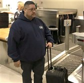 In this Jan. 15, 2018 photo, Jorge Garcia stands at the ticket counter at Detroit Metro Airport while checking his bags in.