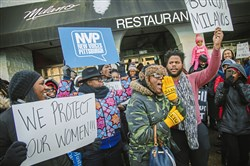 Protesters gather Monday outside Pizza Milano in Uptown in response to a video showing pizzeria manager Mahmut Yilmaz  assaulting Homewood resident Jade Martin.