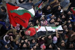 Mourners carry the body of Palestinian Ahmad Saleem, 24, who was killed in clashes with the Israeli army, during his funeral in the village of Jayous, near near the West Bank city of Qalqilya, on Jan. 16, 2018.