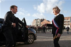 French President Emmanuel Macron (L) is welcomed by mayor of Calais Natacha Bouchart in front of the Calais townhall, northern France, on January 16, 2018.