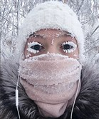 In this photo taken Jan. 14, 2018, Anastasia Gruzdeva poses for a selfie as the temperature dropped to about -50 degrees (-58 degrees Fahrenheit) in Yakutsk, Russia.
