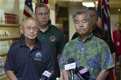 Vern Miyagi, administrator of the Hawaii Emergency Management Agency, left, and Hawaii Gov. David Ige address the false alert of a missile attack that HEMA broadcast Saturday.